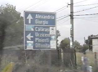 Directional sign indicating the way to various towns
