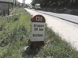 Sign indicating that there are 38 kilometers left until the city Brasov