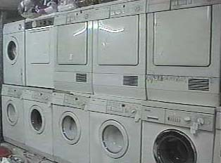 Washers and dryers inside the dry cleaning shop