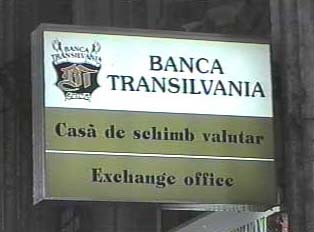 Sign for Transilvania Bank and a money exchange office
