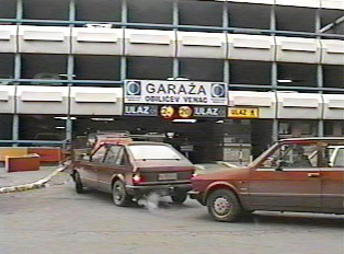 Cars entering the parking garage