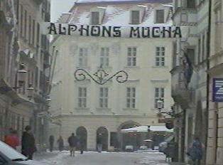 A banner announcing an Alphons Mucha exhibit