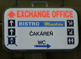 Sign directing to exchange office, bistro, waiting lounge, restrooms