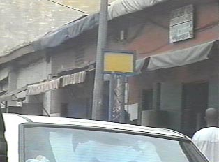 A bus stop sign at Marché Sandaga