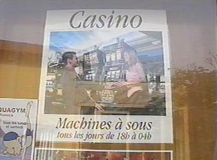 Posters listing the hours of operations of the Casino