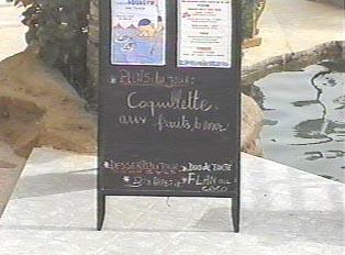 The menu board at the Terrou Bi Complex