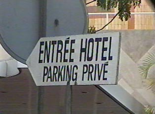 Sign for hotel entrance and private parking