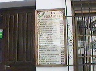 A bar menu posted outside