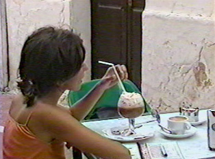 Woman eating in a cafe