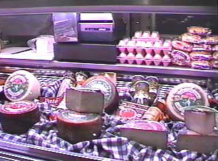 Various Spanish cheeses in a butcher shop