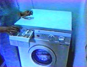 Woman putting detergent in machine