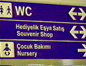 Signs in Turkish and English for services inside the airport