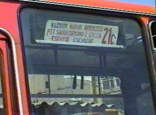 Cardboard sign indicate the bus's origin and final destination