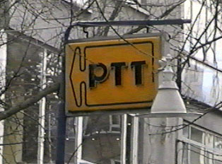 Small yellow PTT sign with an arrow