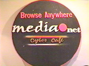 A sign that reads 'Browse Anywhere media net cyber cafe'