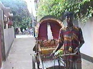 A person pulling a rickshaw
