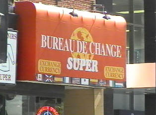 An store-front sign, displaying the name of a currency exchange bureau