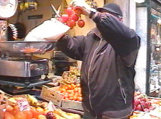 A person weighing produce