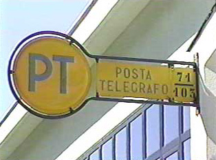 "A post office sign that reads ""PT"""