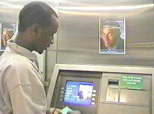 A person at an ATM