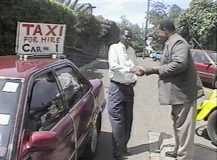 A person paying for a taxi