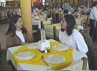 Two people eating at a family restaurant