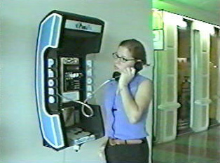 A person using a pay phone