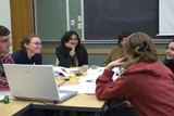Students and language mentors talking around the table